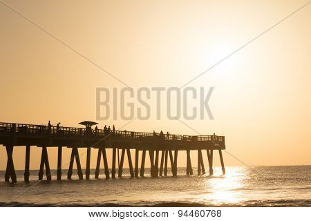 Jacksonville Beach, Florida fishing pier during the early morning.