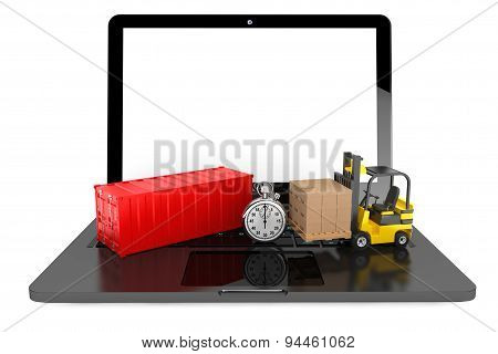 Forklift With Cardboard Boxes And Stopwatch Over Laptop