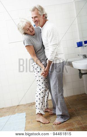Romantic Senior Couple In Bathroom