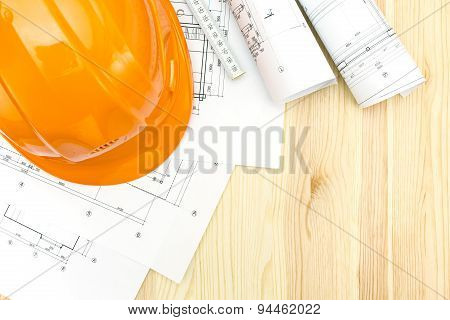 Contractor Workplace With Blueprints And Helmet