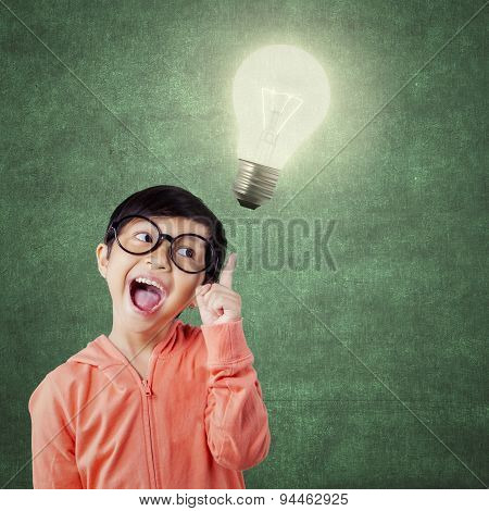 Funny Little Girl And Bright Light Bulb