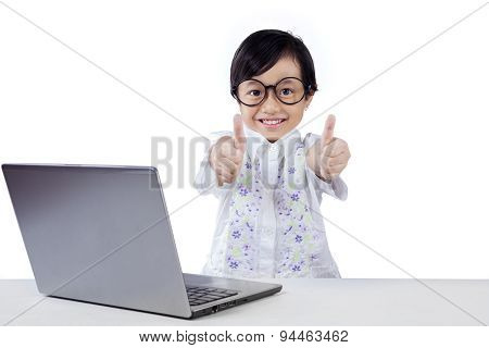 Happy Child With Laptop Shows Hands Gesture