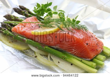 fresh salmon with asparagus in foil paper, ready for cooking