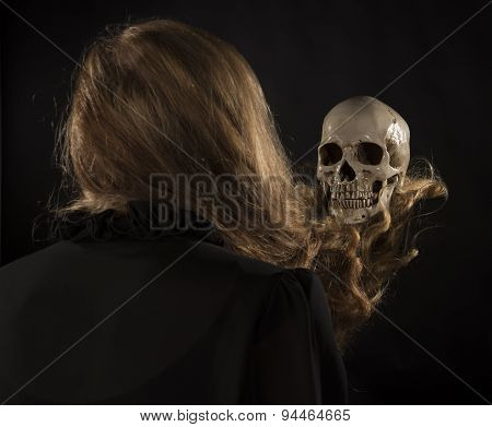 Woman with Blond Hair Holding Skull