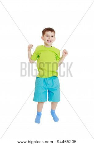 little boy in a t-shirt and shorts jumping
