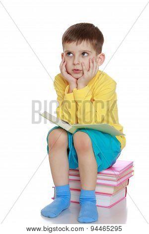 little boy dreams of reading a book