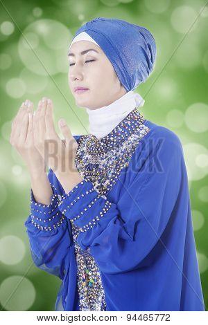 Muslim Woman Praying With Bokeh Background