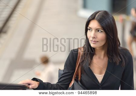 Woman On Escalator