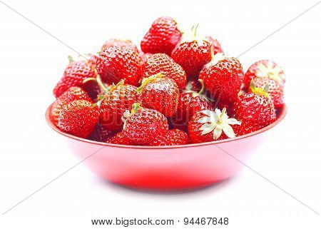 Strawberry In A Red Bowl On An Isolated White Background With Shadow, Side View