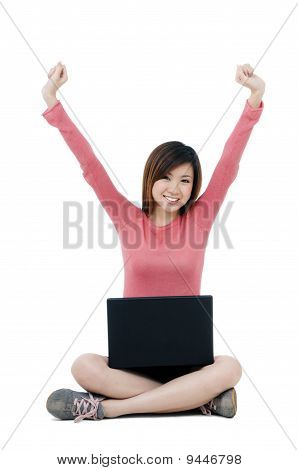 Happy Woman Sitting On Floor With Laptop
