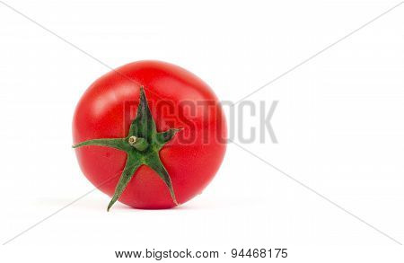 Fresh Tomato With Green Leaves Isolated On White Background
