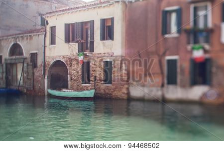 Tilt Shift Photo Of Venice Street With Boat. Soft Focus