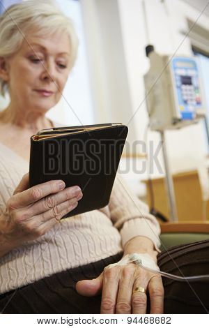 Senior Woman Undergoing Chemotherapy With Digital Tablet