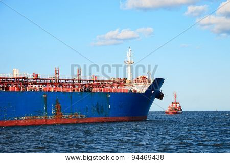 Tugboat Towing A Ship