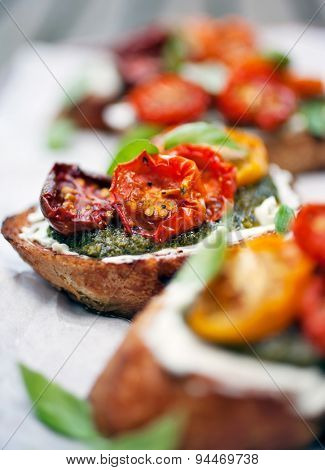 Bruschetta with half dried tomatoes and basil