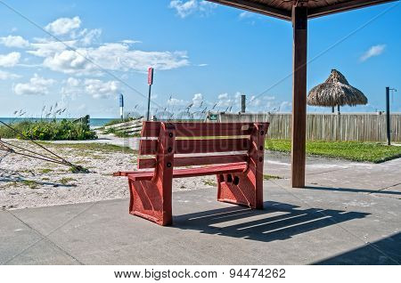 Red bench at the beach