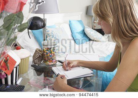 Teenage Girl Writing In Diary