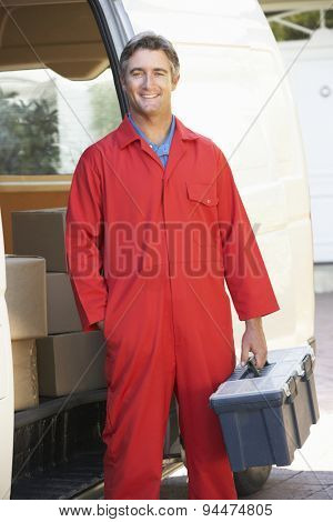 Portrait Of Repairman Arriving In Van