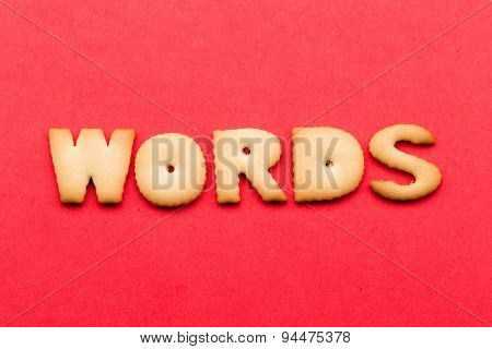 Words biscuit over the red background