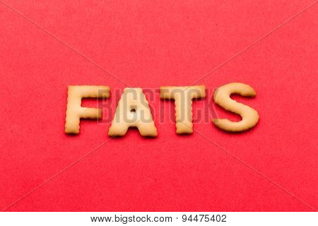 Word Fats biscuit over the red background