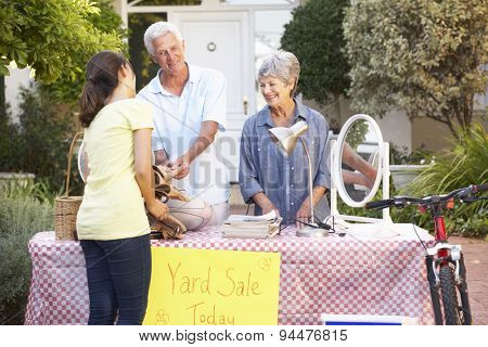 Senior Couple Holding Yard Sale