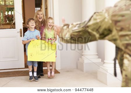 Soldier Returning Home And Greeted By Family