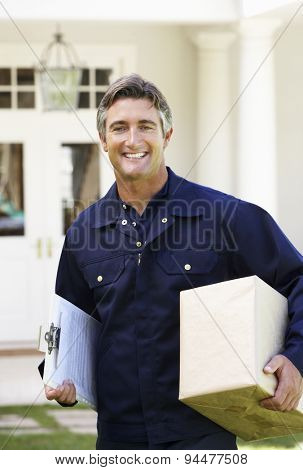 Portrait Of Courier Delivering Package