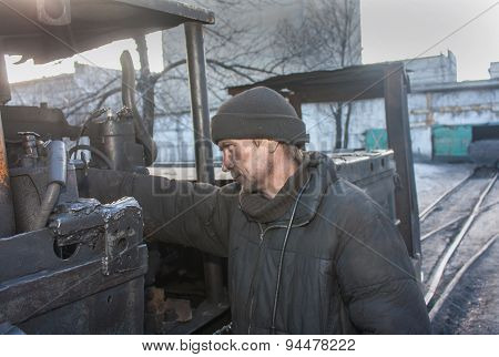Uglegorsk, Ukraine - March 12, 2014: Driver Mine Uglegorskaya Near Trolley Coal Mine Yard