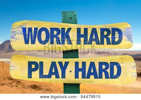Work Hard Play Hard sign with desert background