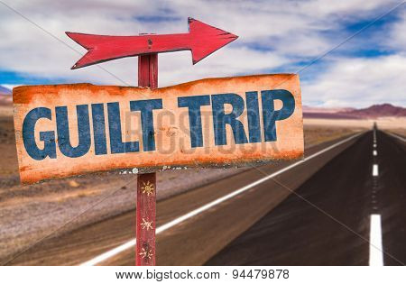 Guilt Trip sign with road background