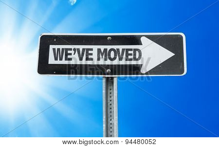 We've Moved direction sign with a beautiful day