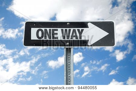 One Way direction sign with sky background