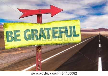 Be Grateful sign with road background