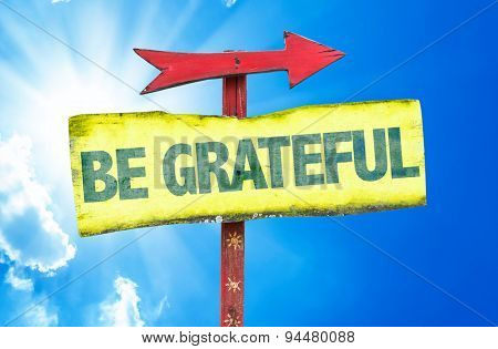 Be Grateful sign with sky background