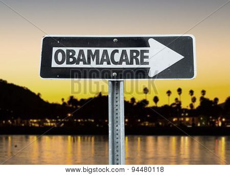 Obamacare direction sign with sunset background
