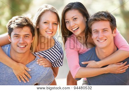 Two Young Couples Out On Summer Walk Together