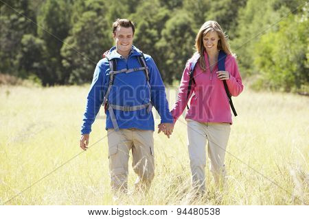 Couple On Hike In Beautiful Countryside