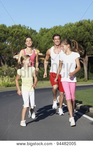 Young Family Running On Road