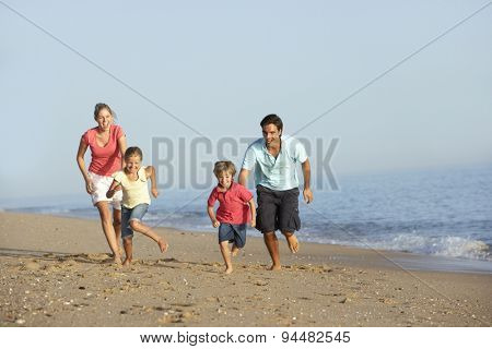 Running Family On Beach Holiday