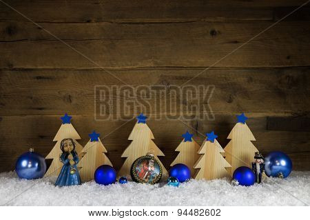 Blue and white wooden christmas background with snow for decoration.
