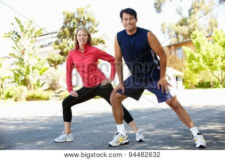 Couple warming up for a run