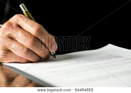 Male Hand Signing A Contract, Employment Papers, Legal Document Or Testament