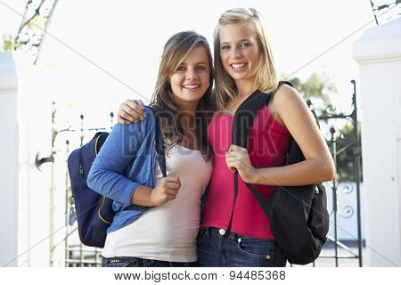 Two Female College Students Standing Outside Gate