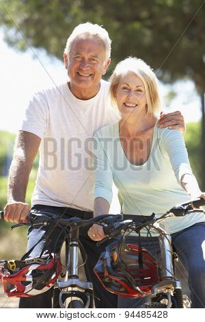 Senior Couple On Cycle Ride Together