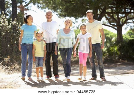 Three Generation Family On Summer Countryside Walk Together