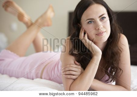 Young Woman Relaxing On Bed