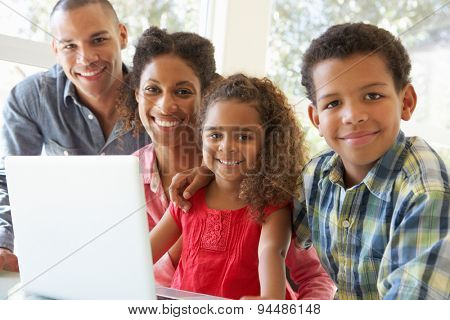 Young Father Using Laptop At Home