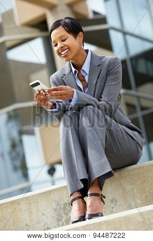 Businesswoman with phone outdoors