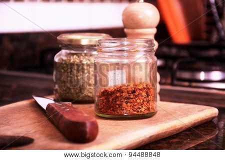 Spices And A Knife On A Cutting Board.