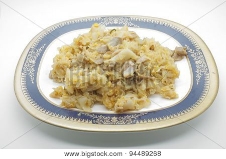 Stir fried noodle with pork in dish